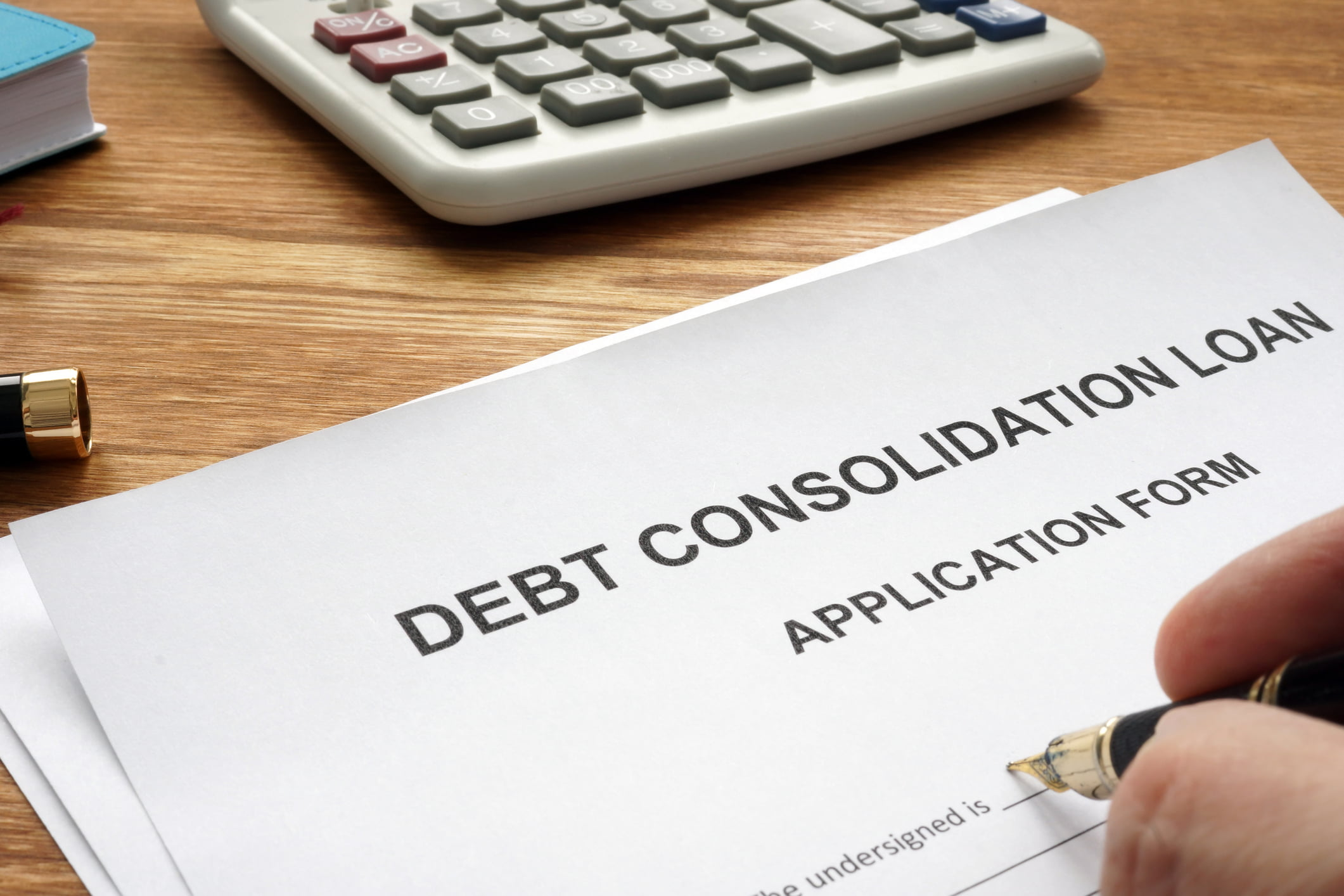 Calvert Home Mortgage | Man filling in Debt consolidation loan application.